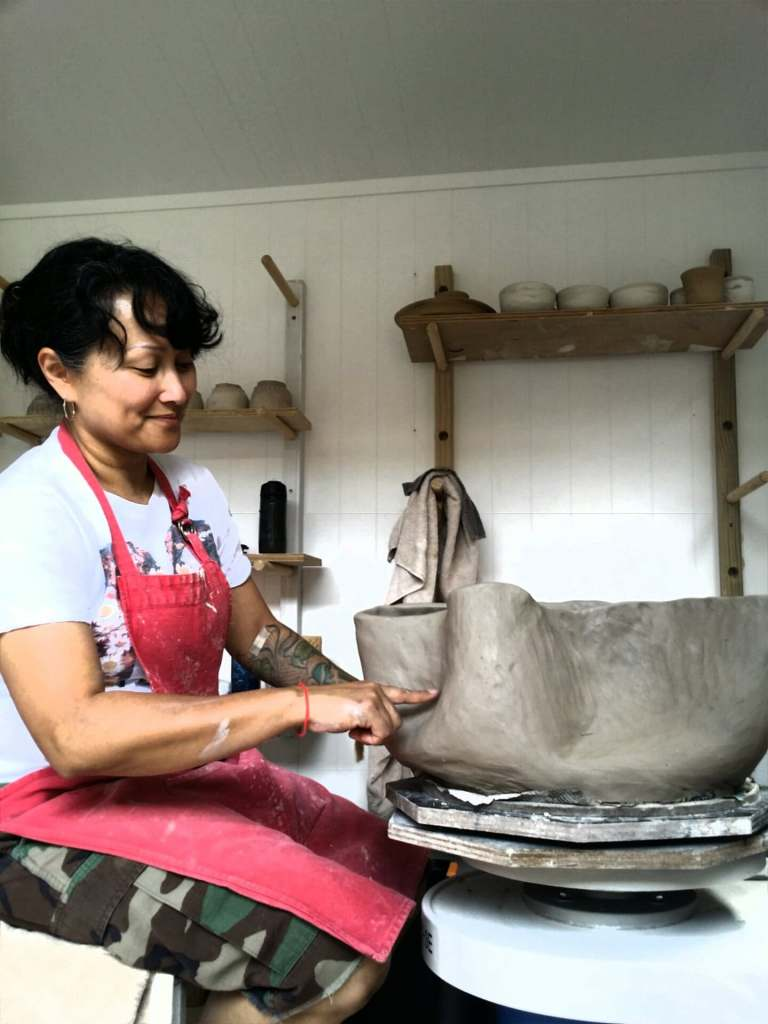 Making pottery for an exhibition during my artists residency.